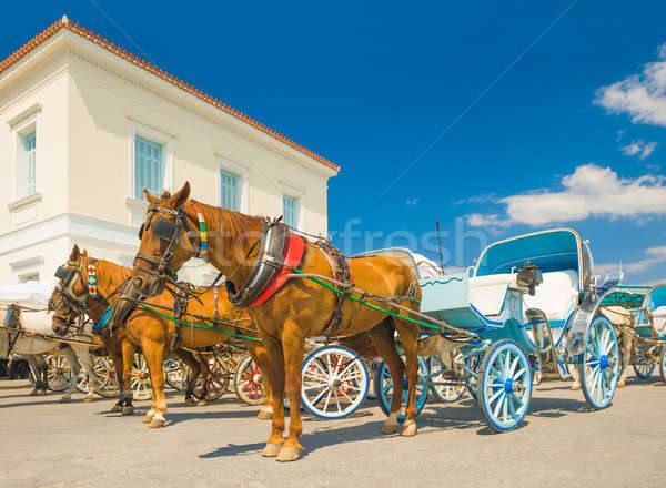 Traditional horse drawn taxis on the island of Spetses, Greece Stock photo © akarelias