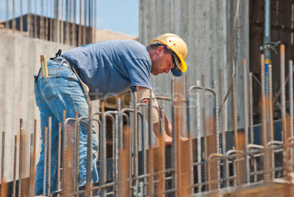 Construction worker busy with forwork frames Stock photo © akarelias