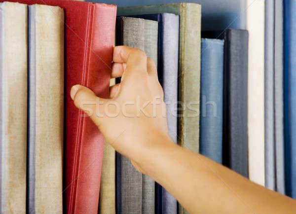 Kiválaszt könyv kép kéz piros oktatás Stock fotó © akarelias