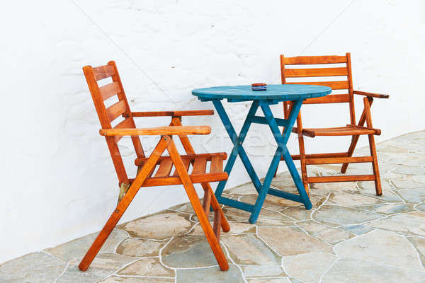 Colorful table and chairs arrangement Stock photo © akarelias