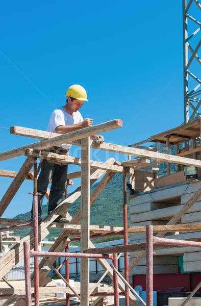 Construction worker on scaffold Stock photo © akarelias