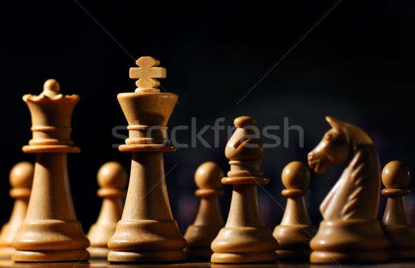 Sakkfigurák kép körül fehér király alulról fotózva Stock fotó © akarelias