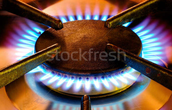 Old gas cooker hob in operation Stock photo © akarelias