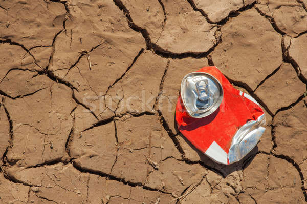 Empty soda can on dry soil Stock photo © akarelias