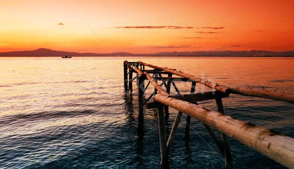 красный закат пирс морем Сток-фото © akarelias