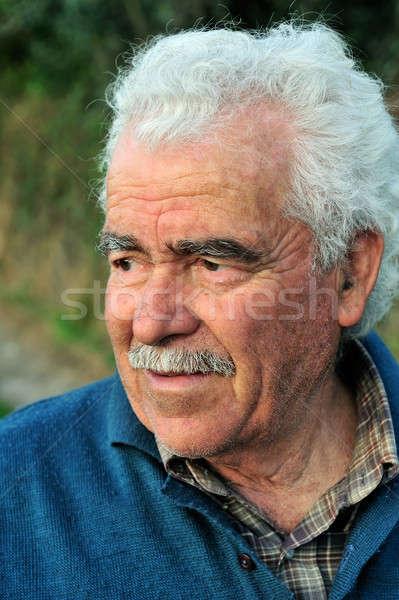 Portrait of a senior farmer Stock photo © akarelias