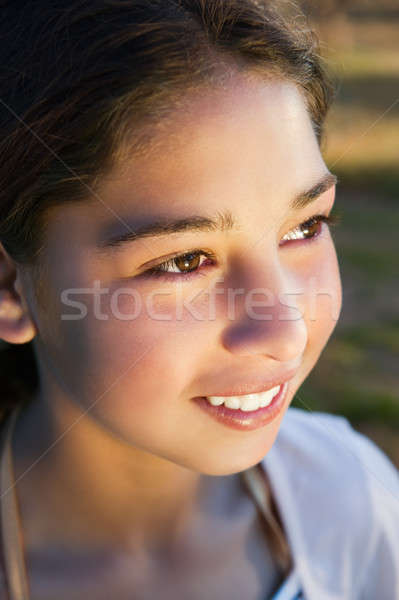 Young gypsy girl smiling Stock photo © akarelias