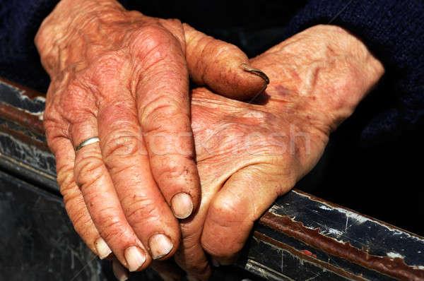 Trabalho duro mãos velhinha velho sinais Foto stock © akarelias