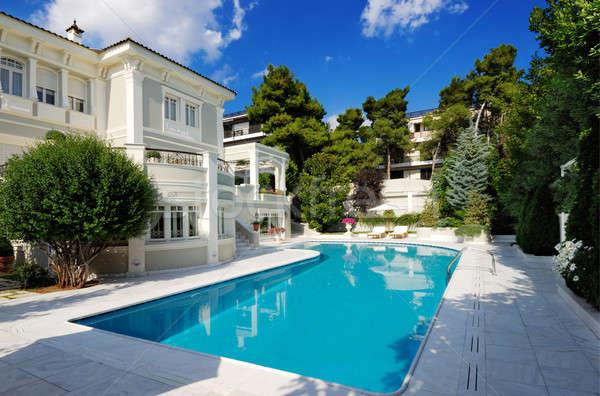 Luxury villa with swimming pool Stock photo © akarelias