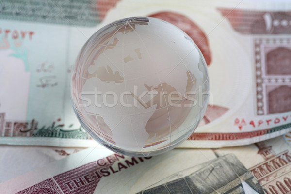 globe on iranian currency Stock photo © Akhilesh