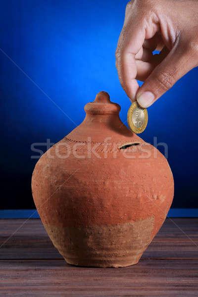Indian Rupee Coin Hand made Piggy Bank - Savings Concept Stock photo © Akhilesh