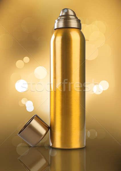 Ouro desodorante perfume lata garrafa bokeh Foto stock © Akhilesh