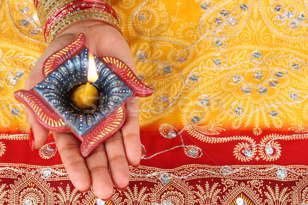 Handmade Diwali Diya Lamp in Hand Stock photo © Akhilesh