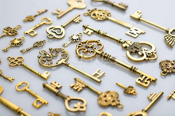 Beautiful Antique Golden Keys on White Background Stock photo © Akhilesh