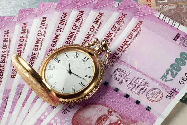 New Indian Rupees Currency with antique time watch Stock photo © Akhilesh