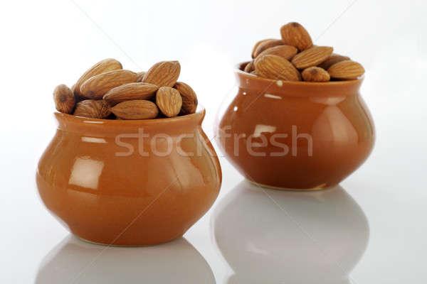Dry Fruits Almonds in Ceramic Pot on white background Stock photo © Akhilesh