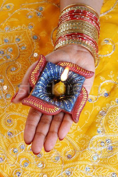 Handmade Diwali Diya Lamp in Hand Stock photo © Akhilesh