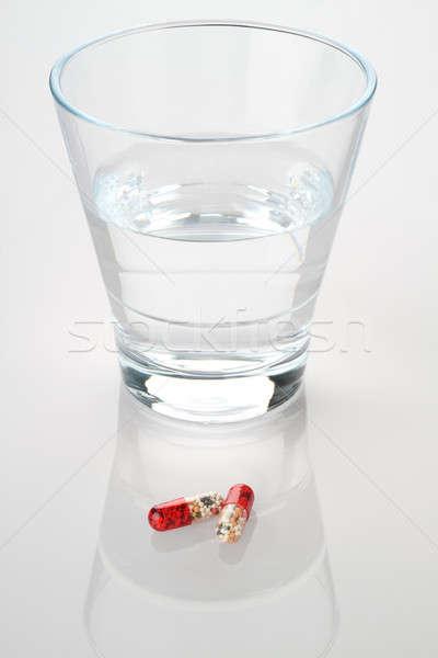 üveg víz gyógyszer kapszulák piros fájdalom Stock fotó © Akhilesh