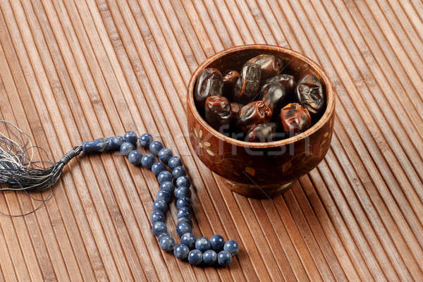 Ramadan Fresh dates in a wooden bowl with rosary Stock photo © Akhilesh
