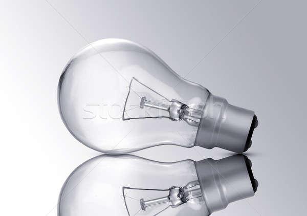 Electric Bulb Closeup isolated on grey background Stock photo © Akhilesh