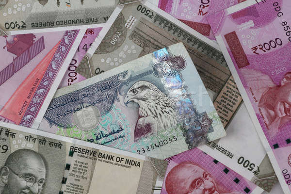 UAE Dirhams between Indian New Currency Bank Notes Stock photo © Akhilesh
