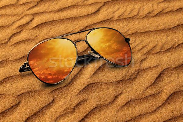 Sivatag homok napszemüveg tükröződés vakáció felhők Stock fotó © Akhilesh