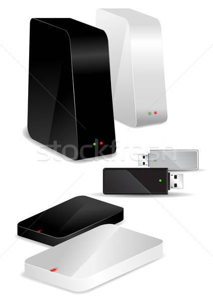 Stock photo: Portable / Desk Hard Disks and USB drive