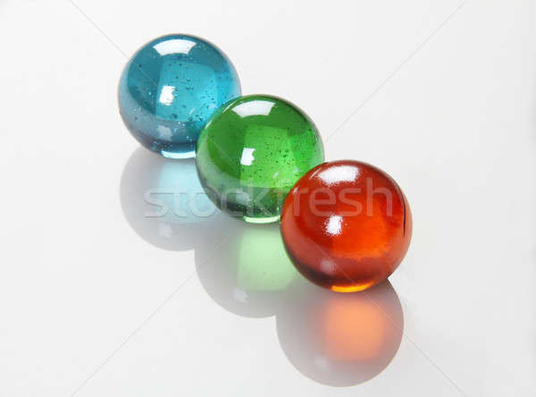 RGB Color Balls / Marbles /Orbs on Reflective Background Stock photo © Akhilesh