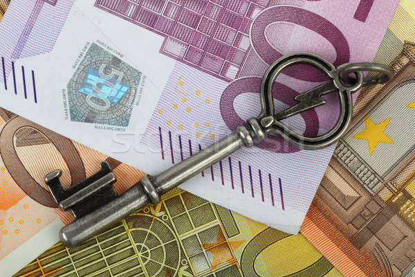 Old vintage key on Euro currency notes Stock photo © Akhilesh
