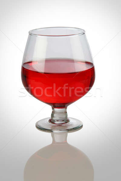 Red Wine Glass on White Reflective Background Stock photo © Akhilesh
