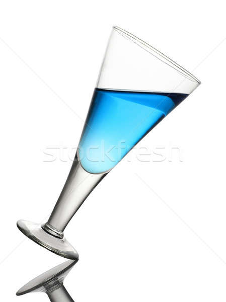 Tilted Wine Glass With Blue Drink on White Background Stock photo © Akhilesh