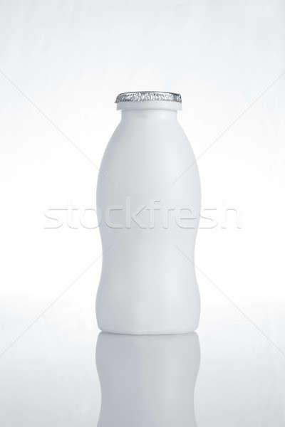 White Plastic Milk Bottle on White Background with Reflection Stock photo © Akhilesh
