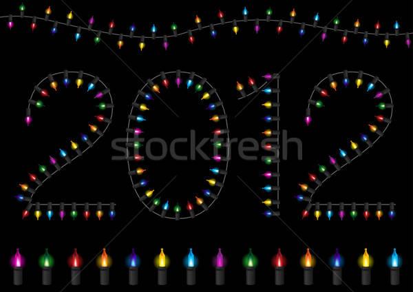 Colorful Festive Glow Light - 2012 Happy New Year Stock photo © Akhilesh
