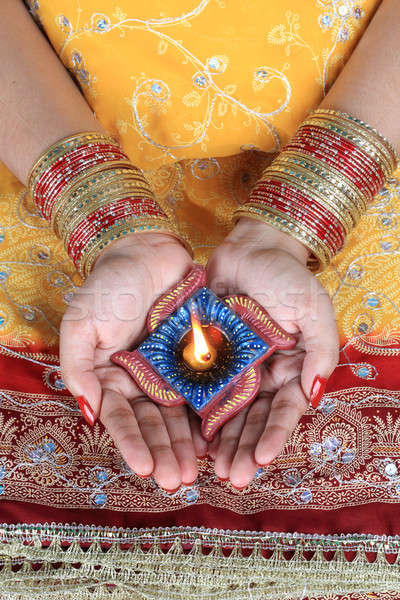 Handmade Diwali Diya Lamp in Female Hand Stock photo © Akhilesh