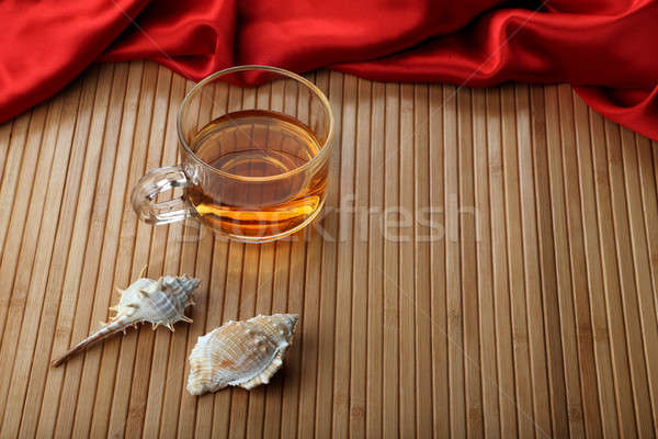 Cup of Tea on Wooden Table Mat with Sea Shells Stock photo © Akhilesh