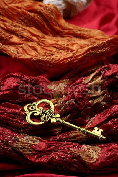 Antique Golden Key on Red Fabric Stock photo © Akhilesh