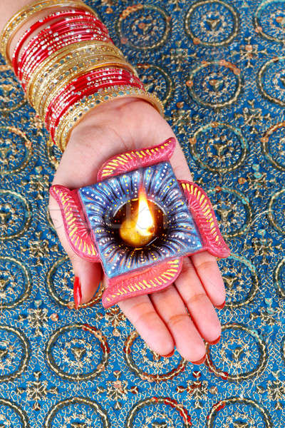 Stock photo: Diwali Celebration Diya on a Female Hand