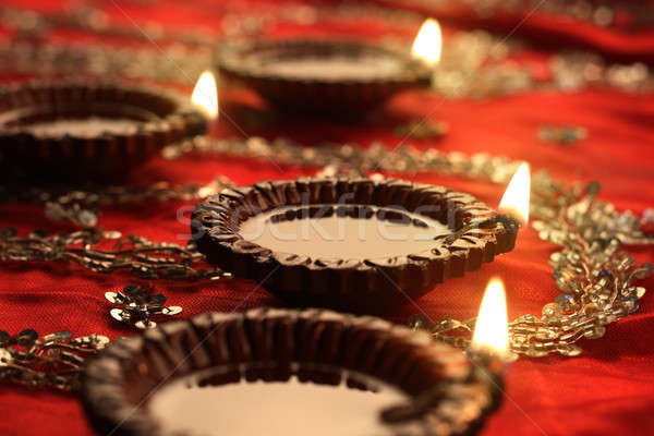 Indian Diwali Diya with Festive Lights and Bokeh Stock photo © Akhilesh