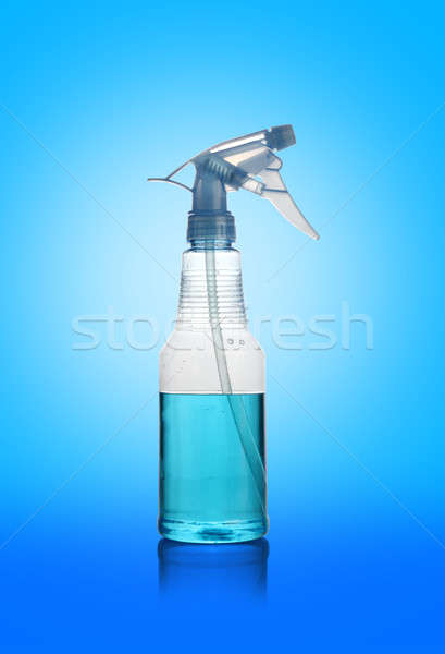 Transparent Spray Water Cleaner Bottle on Blue Background Stock photo © Akhilesh