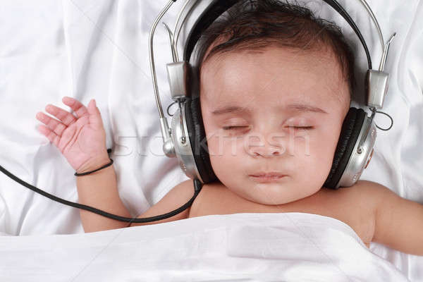 2 Month old baby listening to music with headphones Stock photo © Akhilesh