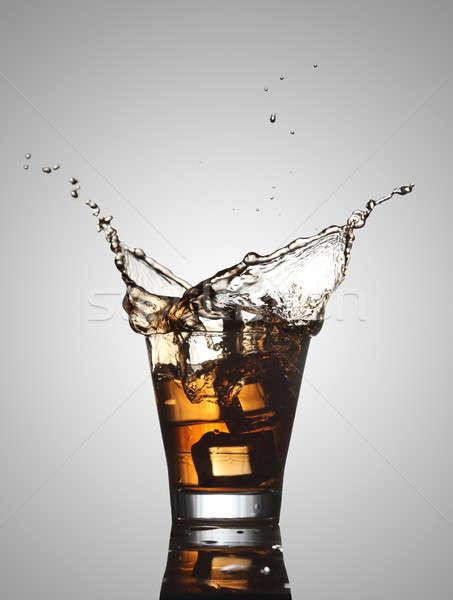 Water / Alcohol Splash with Ice Cubes Stock photo © Akhilesh