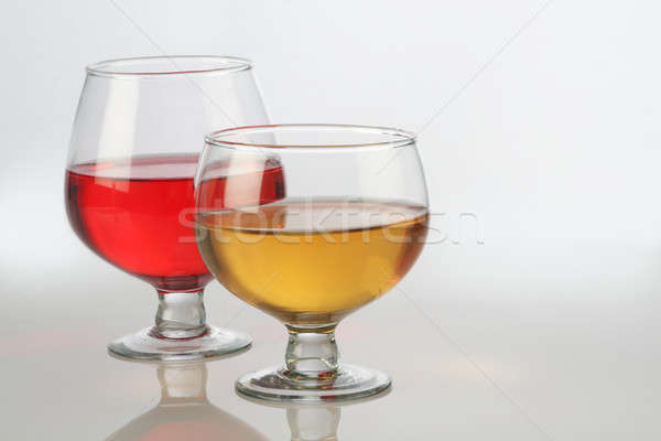Red and White Wine Glasses with Reflection on White Stock photo © Akhilesh