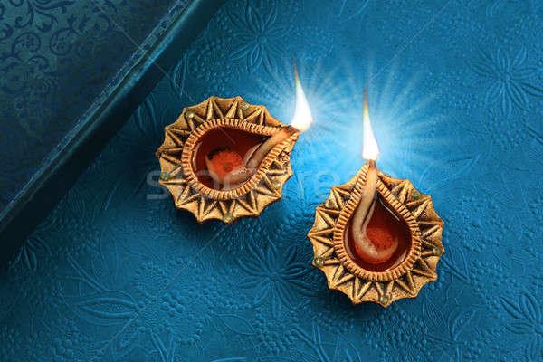 Hermosa dorado diwali lámpara luces azul Foto stock © Akhilesh