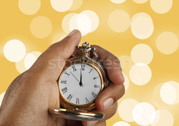 New Year Countdown Concept Golden Antique Watch in a Hand Stock photo © Akhilesh