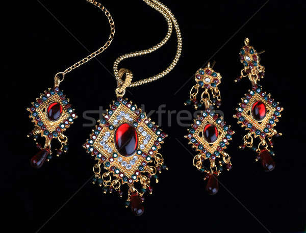 Intricate Indian Gold Jewelry On Black Backgrounds Stock photo © Akhilesh