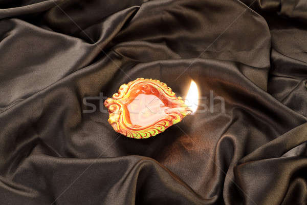 Handmade Diwali Clay Lamp on Black Satin Background Stock photo © Akhilesh