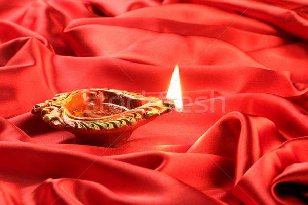 Handmade Diwali Clay Lamp on Red Satin Background Stock photo © Akhilesh