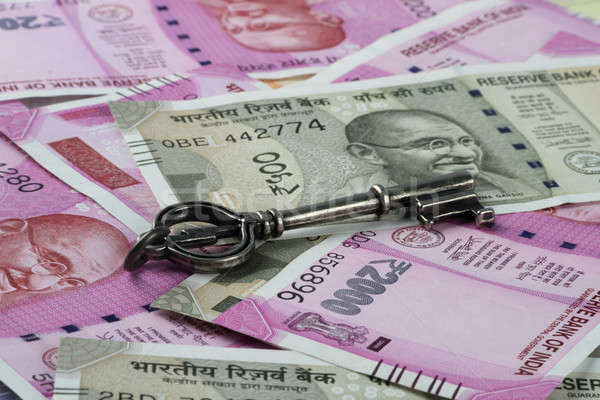 New Indian Rupees Currency with a Key Stock photo © Akhilesh