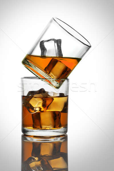 Two Glasses with Whiskey / Rum Drinks with Ice Cubes Stock photo © Akhilesh