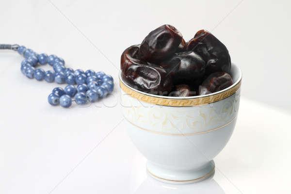 Ramadan fresh dates in a white bowl with rosary Stock photo © Akhilesh